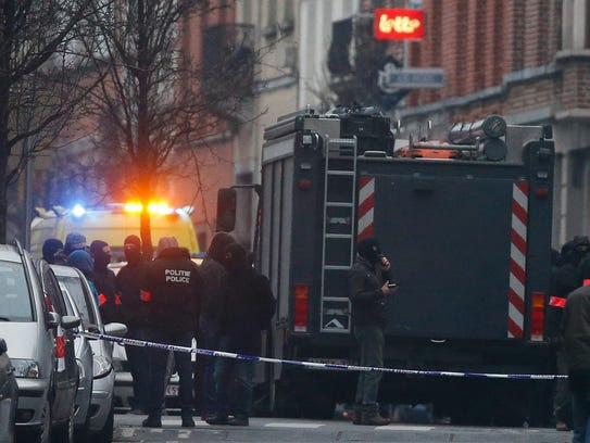 Armed Belgian police forces are seen at the sealed