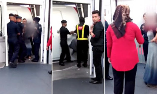 Passenger tries to open door after denied boarding AirAsia flight