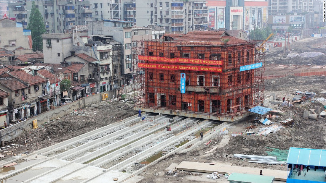 The three-story Hankou Yiyong Fire Association building underwent a monolithic move in 2016, sliding across a set of rails.