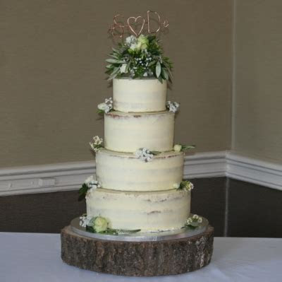 4 tier semi naked cake with green/cream flowers & topper