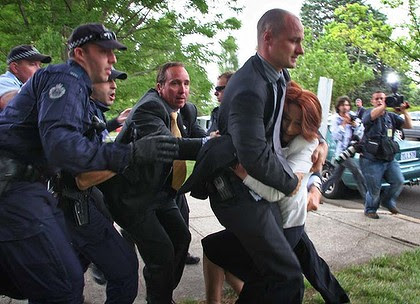 Supplied to The Canberra Times - 26th JANUARY 2012 - NEWS - PHOTO BY VALERIE BICHARD ****PHOTO MUST BE CREDITED TO VALERIE BICHARD**** Valerie Bichard. 0412 170 874.  Prime Minister Julia Gillard is dragged away by her close protection team police to her car after hundreds of protesters from the Aboriginal Tent Embassy descended on the awards ceremony she was at.  ****PHOTO MUST BE CREDITED TO VALERIE BICHARD****  Valerie Bichard. 0412 170 874.