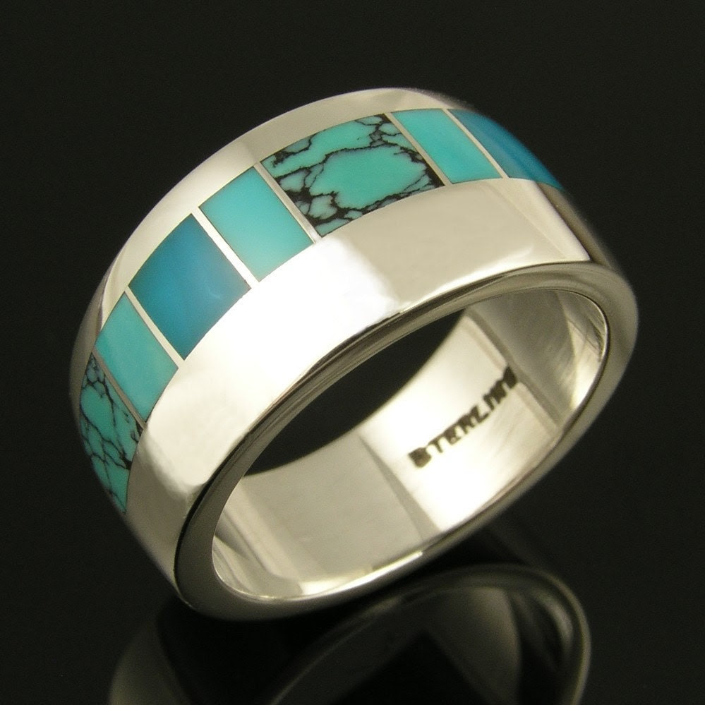 Women's  silver band inlaid with turquoise and gem silica by Mark Hileman.