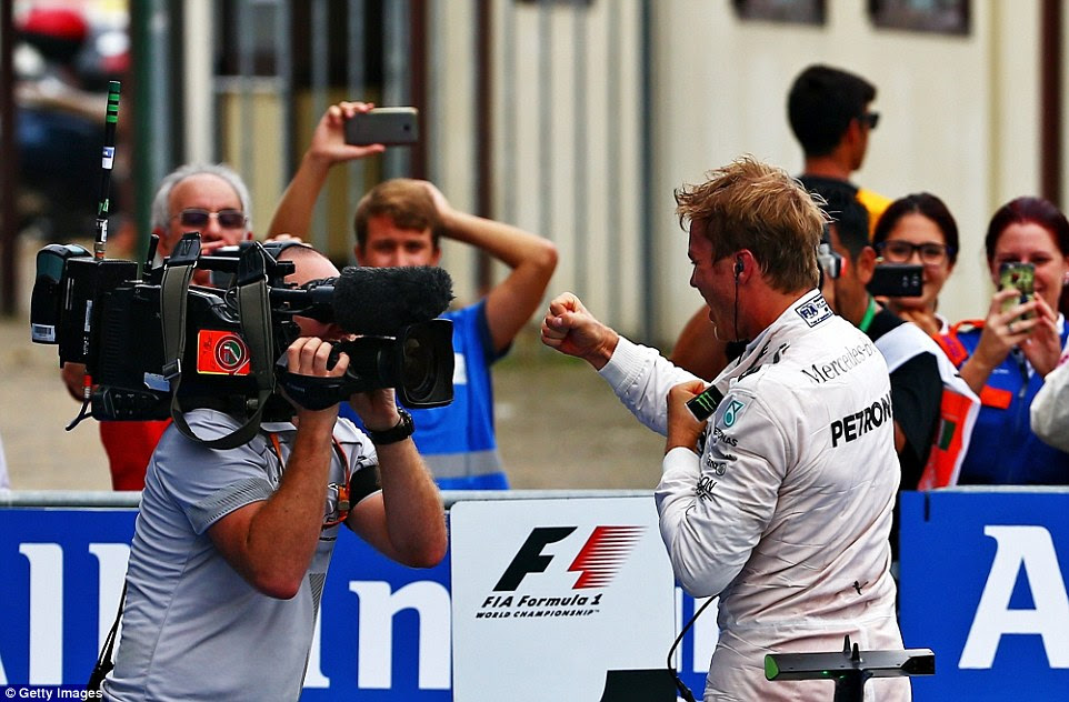 Rosberg shadow boxes in front of a camera man having trimmed Lewis Hamilton's championship lead down to two points
