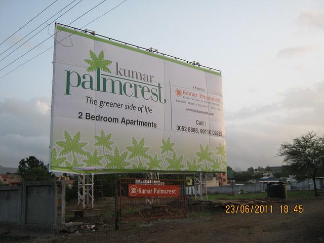 Hoarding at the site of Kumar Properties' Kumar Palmcrest, 2 BHK Flats, off Katraj - Saswad Road, behind Savitiri Palace Mangal Karyalaya, Khadi Machine Chowk (Kondhwa Road) to Undri Chowk, Pisoli Gram Panchayat, Pune 411 028
