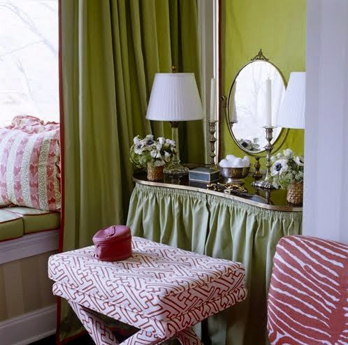 Pink and green vanity vignette by a window seat by Meg Braff. Green skirted vanity table.  Kidney-shaped table. Kidney table. X-bench, X stool, X-stool, X-ottoman