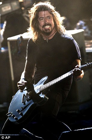 Honourers: Kanye West ganhou um líder sete indicações, enquanto, à direita, Dave Grohl do Foo Fighters viu sua banda nomeada para seis gongos