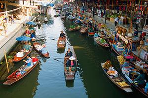 image: photo of vendors along a river