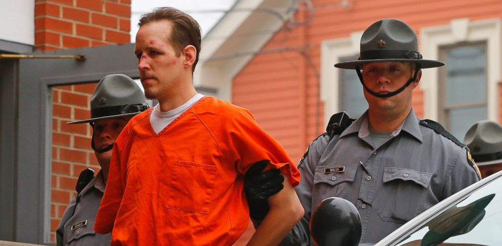 PHOTO: Eric Frein is escorted by police into the Pike County Courthouse for his arraignment in Milford, Pa., Oct. 31, 2014.