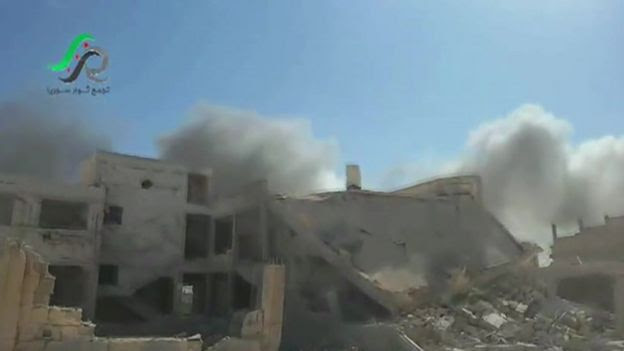 Screengrab from video posted online by opposition activist purportedly showing aftermath of Russian air strikes in Talbiseh, Homs province, Syria (30 September 2015)