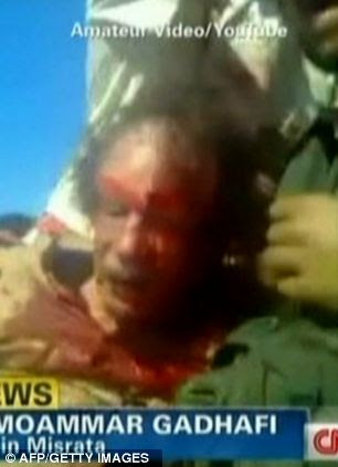 Bloodied Gaddafi's final moments were captured on a mobile phone video