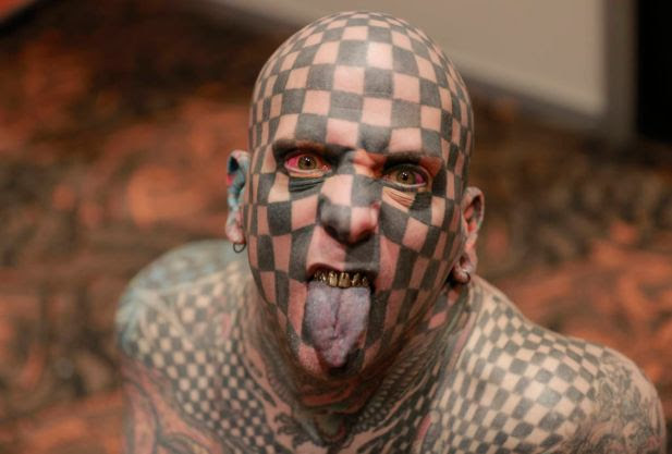 "Matt Gone, known as ""Checkered Man,"" poses for a photo at a during the VIII International Tattoo Artist Convention in Bogota, Colombia, Saturday, Nov. 15, 2014."