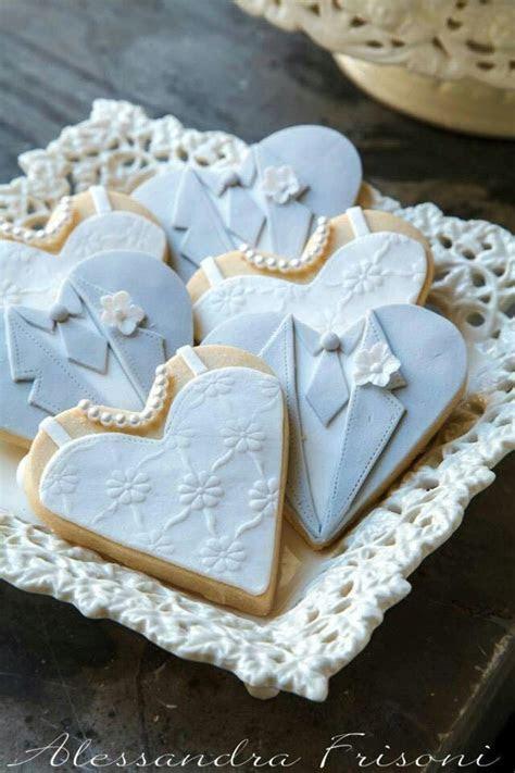 Bride and groom cookies. Very nicely done.   Cookie Jar