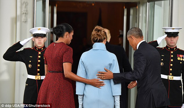 And then they even have their own moment, when both Barack and Michelle put their arms around Melania and walk her inside the White House