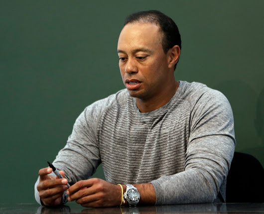 Tiger Woods won't attend this week's Quicken Loans National