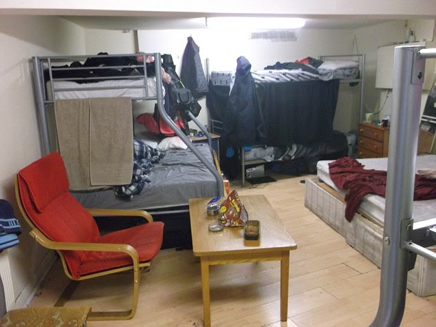 The cramped windowless basement room, where seven people were found to be living in a house in Stratford, East London