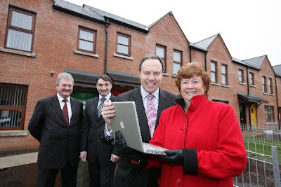 Photo (c) fibresystems.org - Enterprise Minister, Nigel Dodds visits the site of the Next Generation High Speed Broadband Trials on the Ormeau Road, Belfast. Pictured from left to right are: Alan McLeod, Virgin Media's New Developments Manager; John Simpson, Managing Director of Bytel Ltd; Minister Nigel Dodds; Alderman Geraldine Rice, Chair of Clanmil Housing Association.