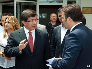 Ahmet Davutoglu outside TRT television's studios in Ankara (24 June 2012)