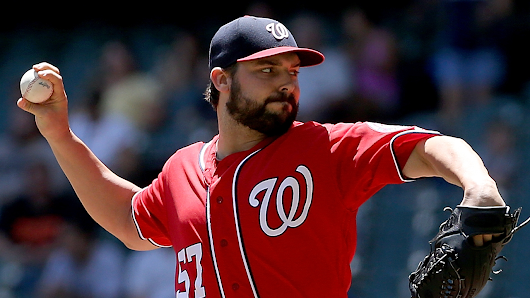 Boosted by HRs, Roark helps Nats end slide