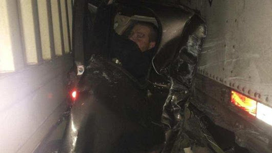 Man survives being pinned between two semi-trucks