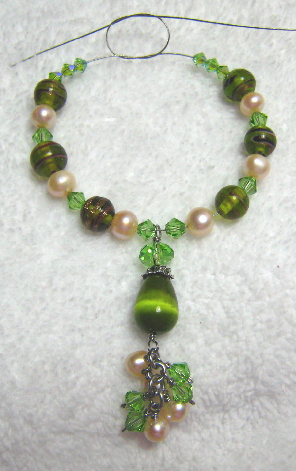 under construction green themed necklace