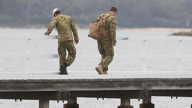 Soldiers search the Australind estuary south of Bunbury. Picture: Bohdan Warchomij