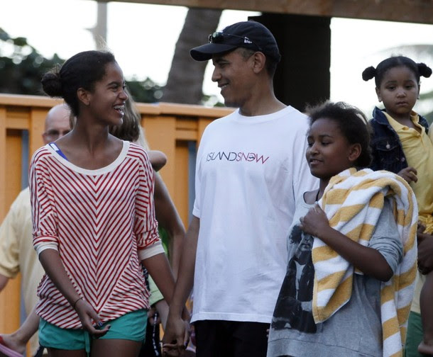 U.S. President Barack Obama walks with his daughters at Sea Life Park in Hawaii