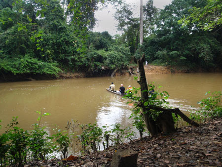 CDC RITE team members ride in a dugout canoe during their journey to Geleyansiesu<strong>,</strong> Liberia, a rural village with reported Ebola cases.