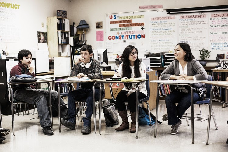 High school seniors in Oakland, Calif., have a discussion with their teacher, Ji Lee, right, about gun laws and public safety last week.