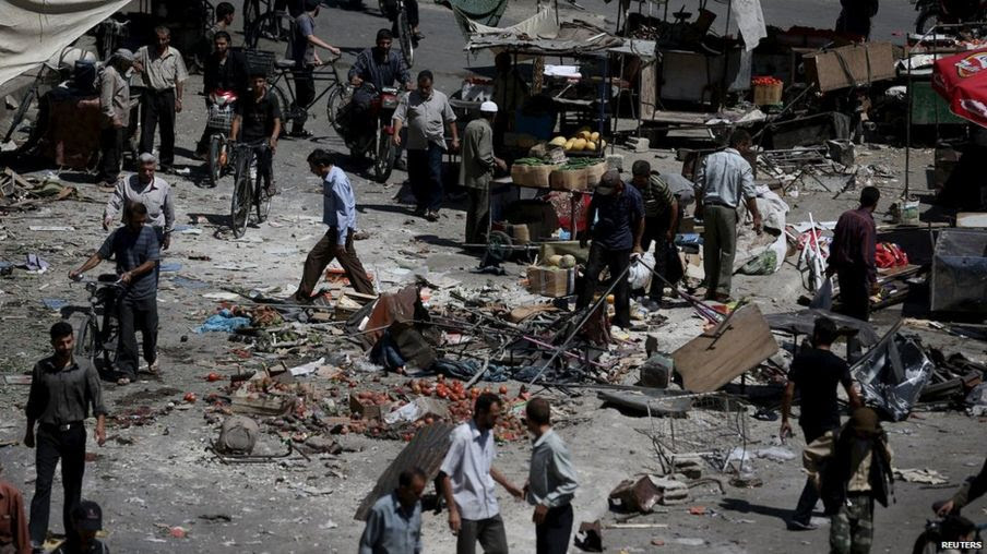 People inspect the damage after what activists said were government airstrikes