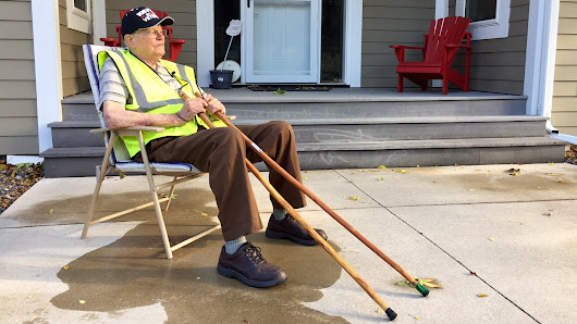 Neighbors put out chairs for walking WWII veteran