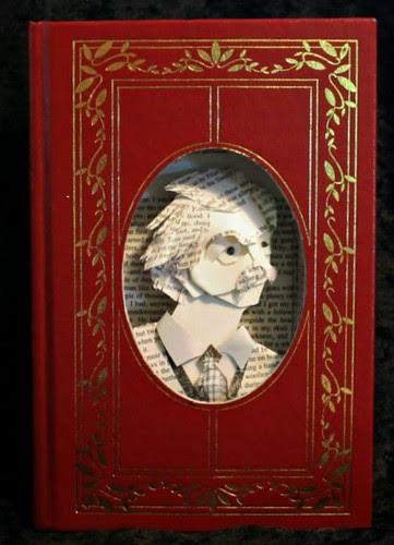 Mark Twain escultura libro retrato