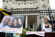 Judy Gross, the wife of Alan Gross, speaks at a vigil in front of the Cuban Interests Section in Washington, Friday, Sept 23, 2011. Gross was arrested in Cuba in December 2009 after being caught illegally bringing communications equipment onto the island. He was sentenced to 15 years in prison for crimes against the state. (AP Photo/Kevin Wolf)