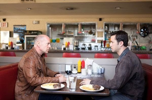 Joe (Joseph Gordon-Levitt) confronts his older self (played by Bruce Willis) in LOOPER.