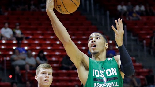 [ad_1] Jayson Tatum lays the ball up as San Antonio Spurs forward Jaron Blossomgame defends during the...