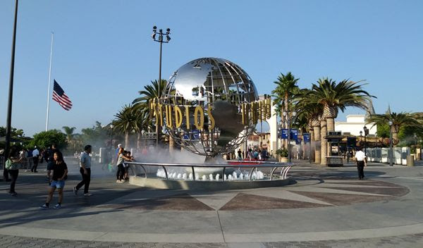 A snapshot of the Universal Logo display and water fountain at the entrance of Citywalk and Universal Studios...on September 1, 2018. The U.S. flag is at half-mast to honor the late Senator John McCain.