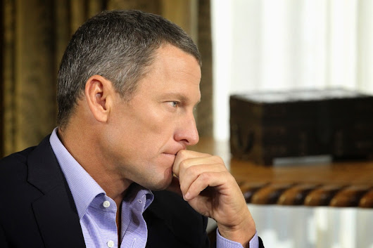 Lance Armstrong cited with hit-and-run after trying to pin it on his girlfriend