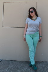 "Green with envy outfit: turquoise moccasins, mint green BDG jeans from Urban Outfitters, heather gray v-neck pocket t-shirt from Gap, Marc by Marc Jacobs sunglasses, ""Sparkled Agate Bib Necklace"" from Anthropologie, etc."