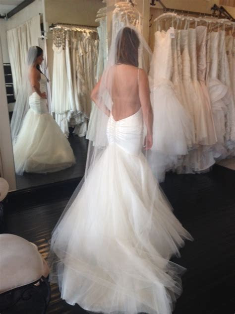 Look at my open back wedding dress!!! Should I add a bow