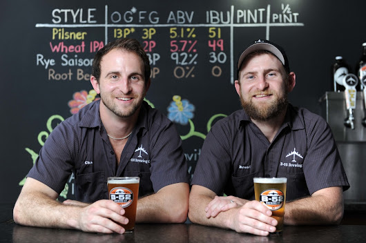 B-52 Brewing signs with Ben E. Keith
