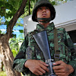 'Not a coup,' says Thai general on television channel he has seized control of