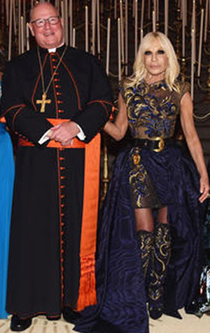 Cardinal Dolan posing with Donatella
