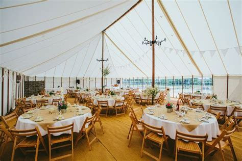 rustic look unlined marquee interior for wedding in essex