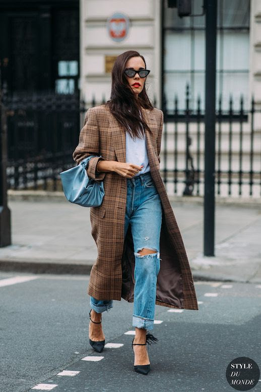 Le Fashion Blog London Fashion Week Evangelie Smyrniotaki Street Style Checked Duster Coat Cat Eye Sunglasses Blue The Row Satin Bag High Neck Blouse Distressed Cuffed Jeans Black Feathered Pumps Via Style Du Monde