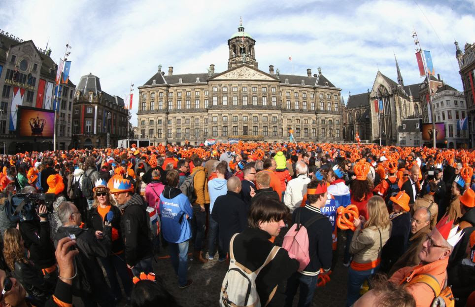 Sea of orange: The abdication followed a 33-year reign marked in recent years by unrest in Dutch society and personal tragedy