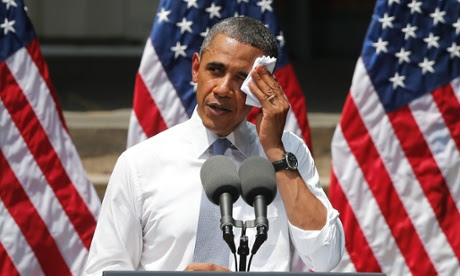 President Barack Obama wiping perspiration from his face as he speaks about climate change at Georgetown University in Washington.
