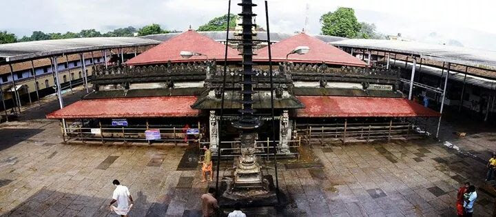 2300 YEARS OLD NON RUSTING PILLAR OF KOLLUR MOOKAMBIKA TEMPLE !!!  About 135 Kms from Mangalore and 80 Kms from Udupi, in the valley of Kodachadri peak of Western Ghats nestles a serene town Kollur. Here is seat of very famous Mookambika Temple on the banks of the never drying river Sauparnika This attractive Mookambika temple with gold plated crest and copper roofs attracts thousands of devotees.This is a well known temple in the Weat Coast of Karnataka and is one of the most important places of pilgrimage attracting pilgrims from all over India. The temple is dedicated to Mookambika and stands on a spur of the Kodachadri peak.  Amazing Metallurgy of India: Many of us would have seen the iron pillar in front of the Qutub Minar in Dilli. That's over 1000 years old and still not rusted in spite of empires changing, weather changing and severe pollution of the capital city. Similarly, the Kollur Mookambika temple's iron pillar in coastal Karnataka, where it rains 6 to 8 months in a year, at a very high 750 cm level per year, has not rusted in over 2000 years! And this was built by tribals of the region, and not some well known architects of the 1st millennium BCE.  Propelled by scientific curiosity as well as deep interest in India's glorious metallurgical heritage, the present author embarked on the adventurous journey to Kodachadri twice during the last eighteen months and undertook some preliminary studies on the material constituting this long-neglected pillar with assistance from fellow-metallurgists at the Karnataka Regional Engineering College, Surathkal; and the Indira Gandhi Centre for Atomic Research (IGCAR), Kalpakkam. Results of these studies, as presented here, confirm the unanimous view of the local residents that this pillar is a product of an earlier period in indigenous iron making, and therefore deserves a detailed and serious study by scientists and technologists devoted to India's metallurgical heritage.  Popularly referred to as the Dwaja-Sthamba (flag-staff) of the MOOBAMBIKA temple, the Kodachadri iron mast or pillar has long been associated in the minds of most scientists, particularly metallurgists, with the pilgrim centre of Kollur, a town located in the plains, about 120 km north of the well-known port city of Mangalore in South Canara District of Karnataka. This temple with claims to be the original Mookambika temple is associated with the killing of the dumb (mooka) demon Mookasura by the lion-riding Mother Goddess in the adjoining forests, where the demon was disturbing the penance of sages and holy men devoted to the Goddess. Today Kodachadri can be reached from Kollur by jeep on a 40 km long winding and slippery mud road with many hair-pin bends, often submerged in water during the rainy season lasting from April to November. The iron flag-staff towers above the small temple (Figure 1 a) and can be sighted a few kilometers away on the road, while approaching Kodachadri. If local lore is to be believed, this flag-staff is actually the top portion of the Tri- (trident) with which the Mother Goddess nailed down the wicked demon into the bowels of the earth!  A platform has been added ostensibly to stabilize the pillar, but with possible un-thought-of and undesirable interactions in due course between the cement of the platform and the iron of the pillar. Rising not less than 10 m above the ground level, with a rectangular cross-section of 8.5 cm ´ 5.8 cm and characterized by rough, serrated and slightly reddish surface the pillar displays evidence on top for local melting, flow of melt and solidification, caused by lightning during the monsoon period. Allowing for a total height of 14 m, including the hidden portions in the platform and below the earth, the weight of this flag-staff can be estimated as about 500 kg.  A very small piece weighing a few grams only was extracted from the projecting rough surface of the pillar with the consent and cooperation of the temple priest and was later subjected to a series of modern metallographic tests at the Materials Characterization Laboratories of the Indira Gandhi Centre for Atomic Research, Kalpakkam. To the author's surprise, the X-ray examination could not reveal definite presence of any element or compound besides pure iron while the microscopic study revealed only grains of iron with very little pearlite (eutectoid of iron and Fe3C, i.e. iron carbide generally referred to as cementite). However, a few greyish and many rather large dark inclusions (Figure 2 a and b) were noticed and could be subjected to microhardness testing and electron microprobe analysis. While the small globular inclusions could be identified as iron silicate containing some calcium (Ca) and phosphorus (P), the bigger irregular-shaped ones consisted of only iron oxide (Fe2O3) with traces of other elements like silicon (Si), calcium (Ca) and phosphorus (P). The VHN microhardness numbers were around 140 for the iron grains, about 155 in the pearlite-cum-matrix areas, and around 165 in the dark inclusions. From image analysis, the volume fraction of all the inclusions was estimated as less than 2.0%. It was not possible to arrive at the exact volume fraction of the greyish pearlitic area, but assuming it to be around 1.0%, the carbon content of the pillar iron can be estimated as definitely less than 0.05%.  It is obvious from these preliminary investigations that the Kodachadri iron pillar is not a product of modern iron making processes. The composition of the material of the pillar, viz. less than 0.05% carbon in what looks like almost pure iron, without the usual silicon, manganese and sulphur contents one associates with modern iron and steel, and with inclusions of only iron oxide and silicate, strongly suggests age-old indigenous methods for making the so-called Adi-vasi (tribal) iron with pure iron ore and wood charcoal. The fact that this pillar has withstood the onslaught of the sun, wind and rain in living memory,and perhaps also of marine air with the Arabian Sea only 40–50 km away, is proof of its high corrosion resistance, even though its surface is not as smooth and clear as that of the Delhi pillar. Acting as a lightning arrester during the rainy season, the top of the pillar seems to have melted frequently and perhaps rapidly solidified through removal of heat by iron from the pillar itself. A metallographic study of this part of the pillar is bound to yield some interesting results.  The data reported here, although from a very small piece of the pillar, point to the need for a more thorough and systematic scientific, technological and archaeo-historical study of this iron mast, towering alone in its majesty in a remote hilly and forest area of Karnataka.