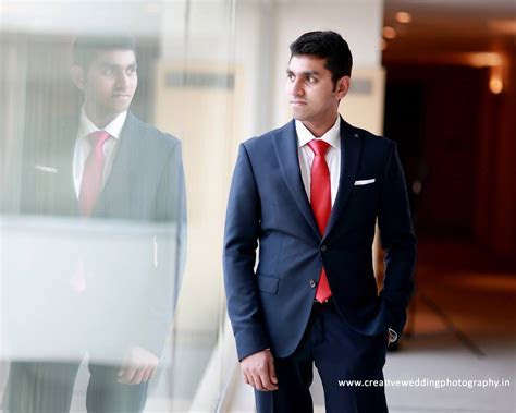 Royal Blue Suit with plain red tie   Photo Gallery