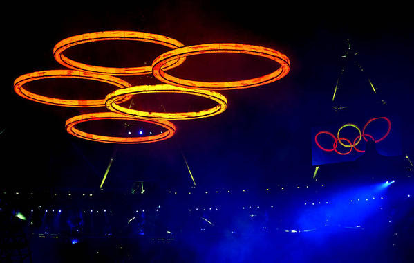 The Olympic rings are assembled above Olympic Stadium at the opening ceremony Friday.
