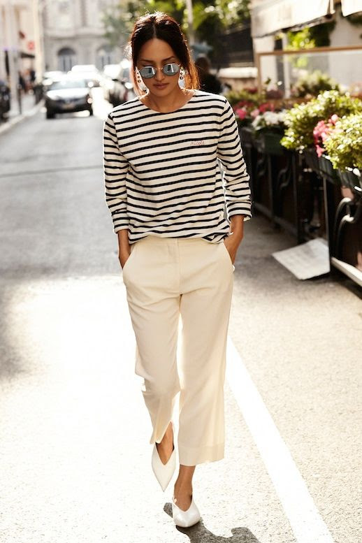 Le Fashion Blog Parisian Style Low Bun Mirrored Round Sunglasses Striped Long Sleeve Shirt Cropped Cream Pants White Pointed Celine Flats Via Gary Pepper