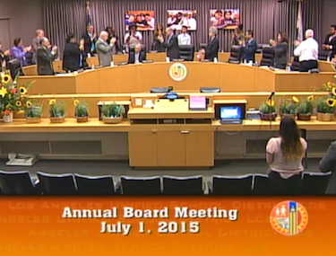 The LAUSD school board gives Superintendent Ramon Cortines a standing ovation.